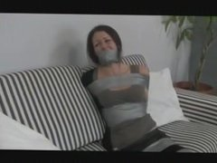 Girl tied and gagged with duct tape by man 4