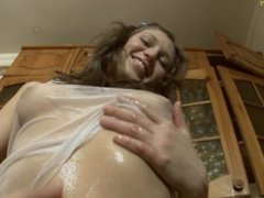 Little Young Girl Teasing Oiled Body
