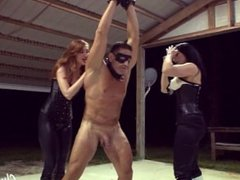2 Mistresses Ballbusting a Muscular Bodybuilder Slave (Femdom) Tied up