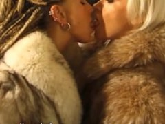 Girls kissing in fox furs