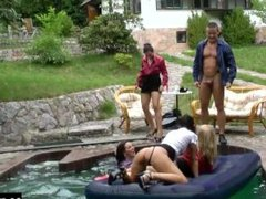 The poolside fuck party moves into the water as one sexy slut jumps