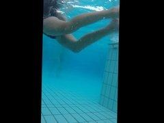 girl with nice body bikini underwater at pool