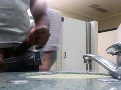Black perv caught jerking in restroom