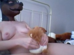 Rubber doggy masked girl is quite kinky