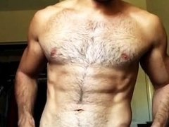Hairy hunk teases with his big bulge