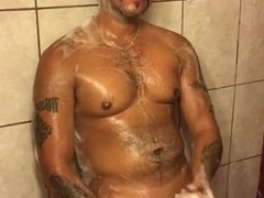 Soaped up daddy plays with his piss