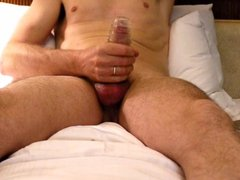 Jerking off with sheath - cum fountain through uncut cock