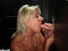 Mature Mom sucking cock at gloryhole