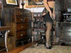 Classy secretary in black ff nylons