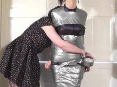 Girl tape mummified and gagged by woman