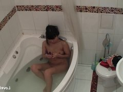 Bathtub masturbation of the breathtaking Asian girl