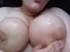 Gorgeous big titted girl fingers herself covered in a load