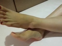 Chinese student shows off her feet for some cash.