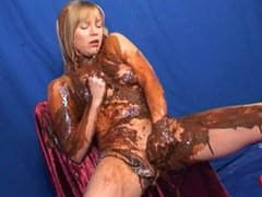 Bikini blonde strips and masturbates with vibrator in a stream of chocolate