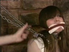 Harem Girl In Heavy Shackles And Chains Dragged And Fastened By Master