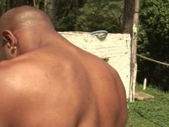 Muscular black guy jerks off by the pool