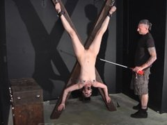 Clamped, Prodded and Whipped on a Cross