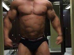 Bodybuilder flexing huge biceps