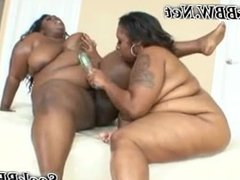 Huge Black Lesbian Kisses Her GF and gets a Dildo