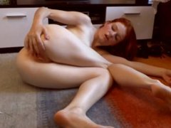 REDHEAD MILF SUCKING HER OWN TOES