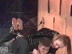 Mistress Julie Simone hogties a man in a TV show