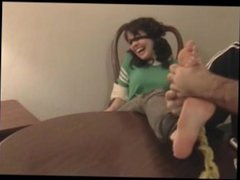 Amy tickled on the table