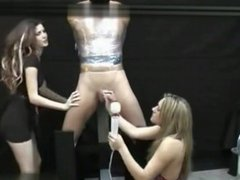 Two sexys girls masturbates a tied and gagged guy