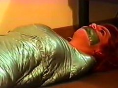 Girl tape mummified gagged by girl