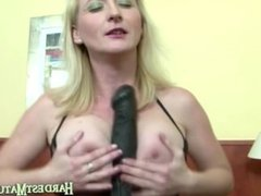 Mature blonde plays with her ass