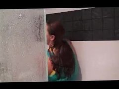 Hot girl are showering with fully clothes