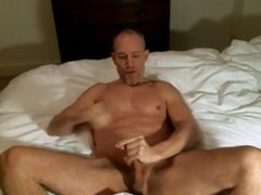 Bald Muscle Hunk Jerks Off