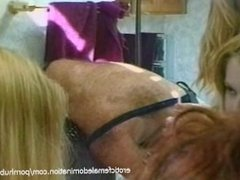 Stunning blonde looker teaches girls how to suck on a cock