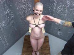 Sexy, Bald Submissive Tied to a Post for Nipple Torture