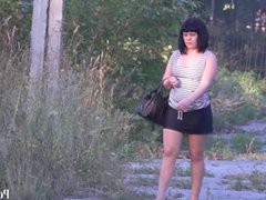 young girl in a public place in pantyhose without panties