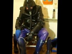 Pissing and wanking in rubber which has already been pissed on by a friend.