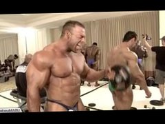 Bodybuilders pumping up back stage