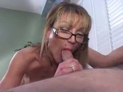 Mature gives a blowjob and smokes a cigarette