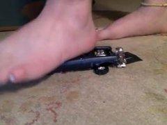 Toy car crush barefoot