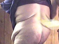 Man gets wooden paddle from BBW woman, then she gets it too