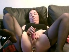 Solo mature masturbates with buttplug in ass