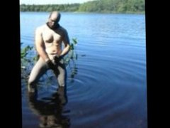 jerking off in lake wearing spandex tights, latex gloves and stocking mask