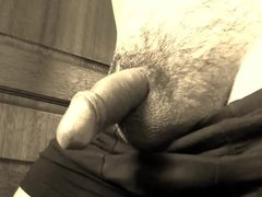 Precum begins to flow from tiny cock