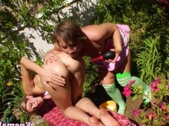 Enema strapon lesbos assfucking outdoors