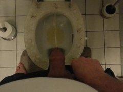 Pissing on toilet