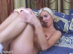 Nasty blonde big tits teen bitch putting a fat dildo in her