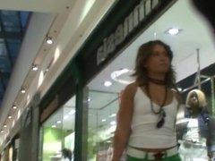 Hot slut in green shorts shopping