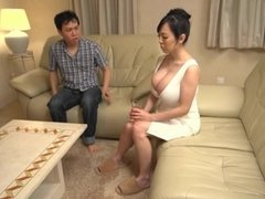 Japanese with monster big tits teasing a guy in the living room
