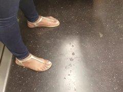 Candid sexy ebony feet in sandals