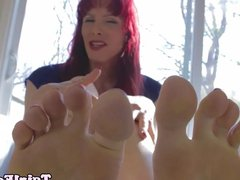Redhead footfetish ts plays with her cock