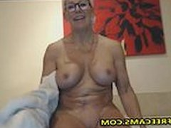 Busty Blonde Mature Takes Shower And Masturbates